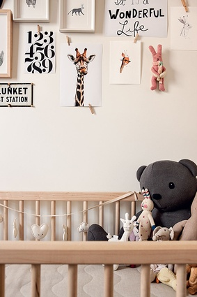 Ivy's bedroom wall is decorated with prints and illustrations of animals.