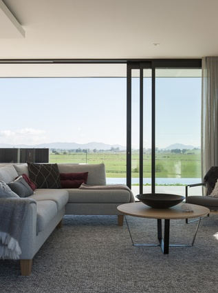 The family room enjoys all-day sun and views of the Hakarimata Ranges.