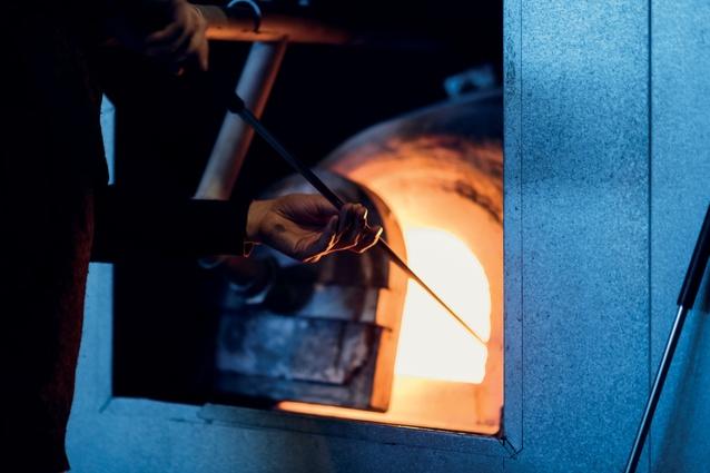 The furnace runs at around 950°C.