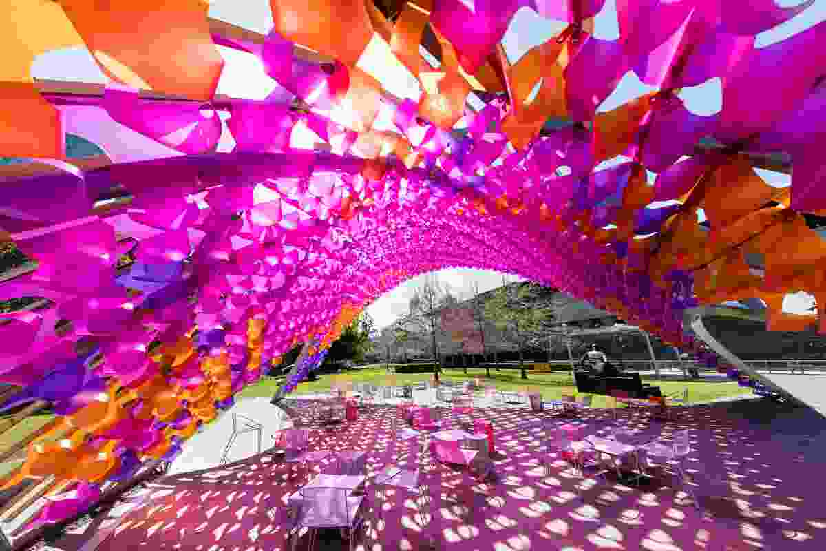 The underside of the 2015 Summer Architecture Commission by John Wardle Architects is clad in 1,350 hand-folded polypropylene blooms.