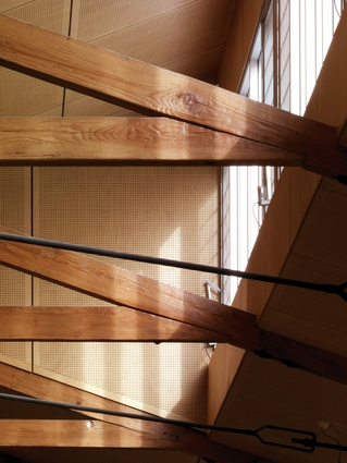 Roof detail, showing repaired Oregon trusses complemented by ply ceiling panels.