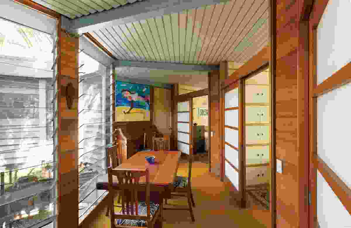 Floor-to-ceiling glass louvres to each part of the inner perimeter draw in river breezes and illuminate the interior. Artwork: Stephen Baxter, That Japanese princess with silicone breasts and Taiwanese ball who own Surfers Paradise, 1988.