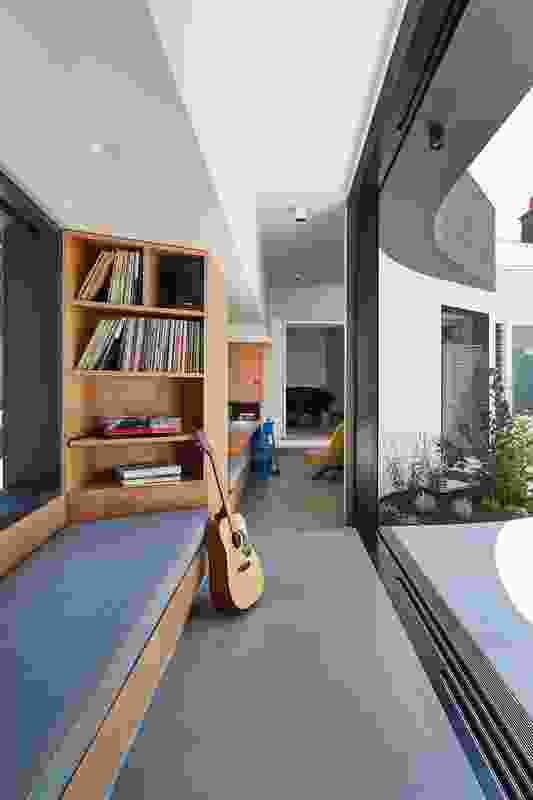 A multi-use corridor and living space connects the extension with the existing house.