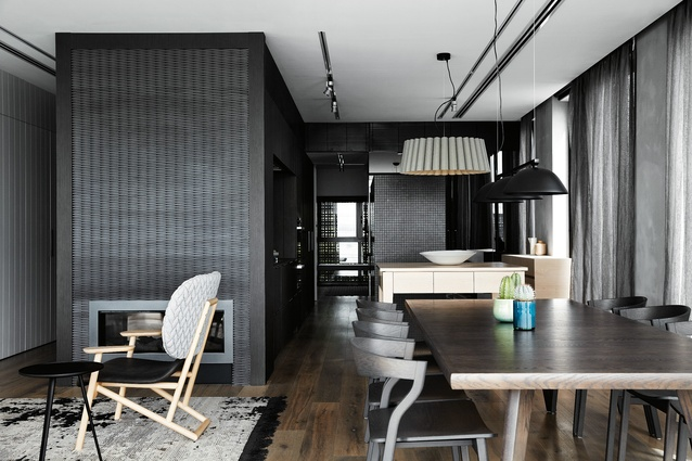 Central to the deign is a black box-like joinery unit housing the kitchen. It is subtle and unexpected, and the kitchen's function is not immediately apparent.