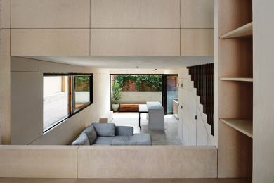 The architects sank the lower level into the ground so as to include a third level while satisfying height restrictions.