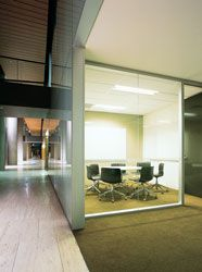 """Meeting rooms within the glazed """"bar"""" define the boulevard edge."""