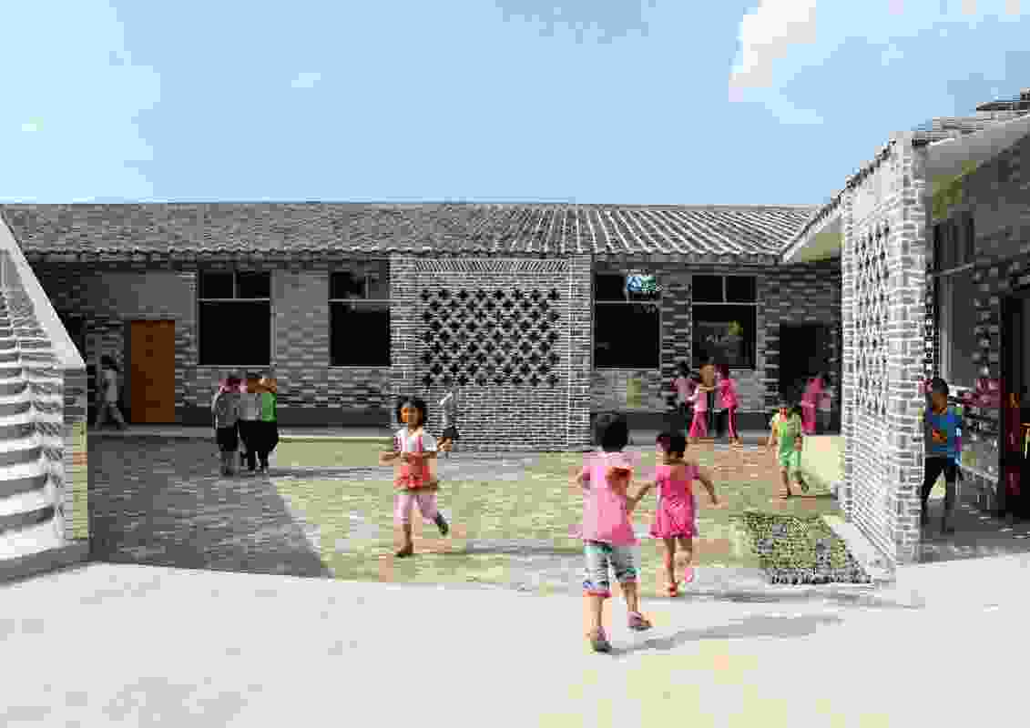 Mulan Primary School was extended by Rural Urban Framework to provide a new toilet block, playground and a building for additional classrooms. Mirrored ceramic tiles cover the toilet block and parts of the playground steps.