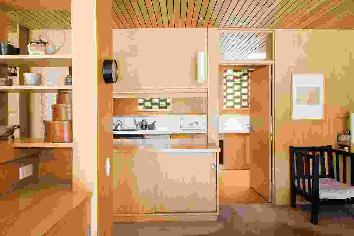 A pull-down screen over the kitchen/dining counter allows the workings of the cook