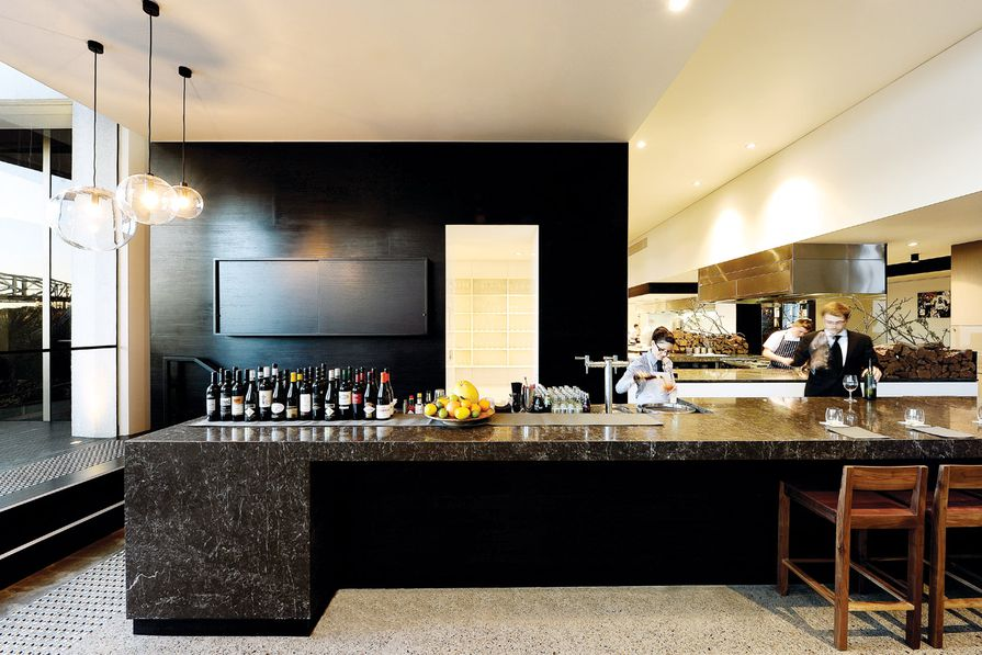 The bar's design is clean and simple, with hand-blown glass ball lights suspended above.