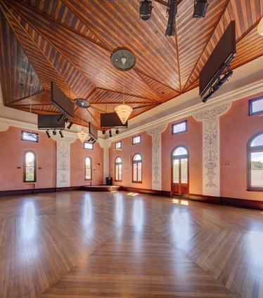 The restored main hall regains its original pink plasterwork and elaborate ceilings of  red cedar and pine.