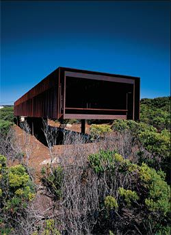 The cantilevered building appears as a telescopic form aimed at the view of the sea.
