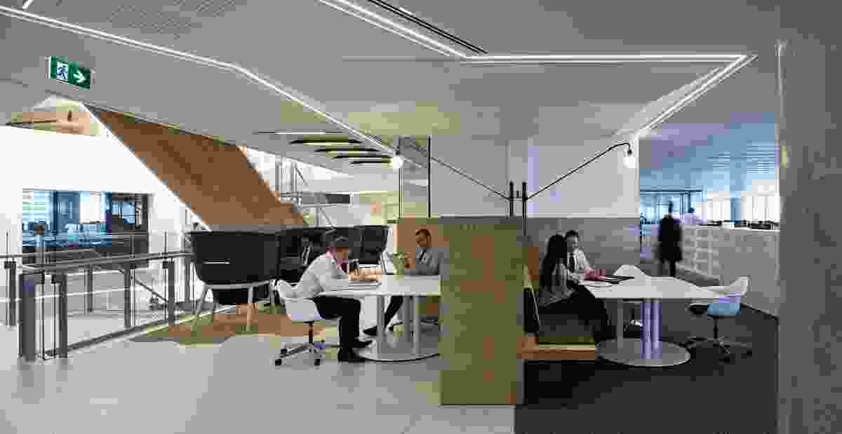 Communal work tables and meeting rooms give staff a variety of options to move between.