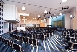 The flexible auditorium can be divided into three or used as a single space for worship in either blackout or day-lit conditions.