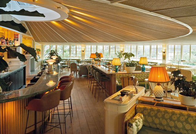 """Rattan panels accentuate the form of the ceiling and are a reminder of """"a straw hat that would have been worn on a paddle steamer."""""""