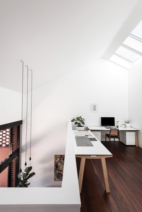 A void to the lower level provides connection and transparency between adjacent living spaces.