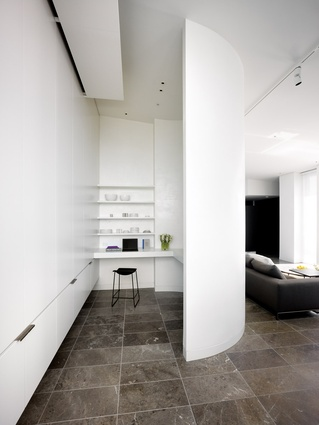 The spacious pantry is tucked behind one of two curving white walls.