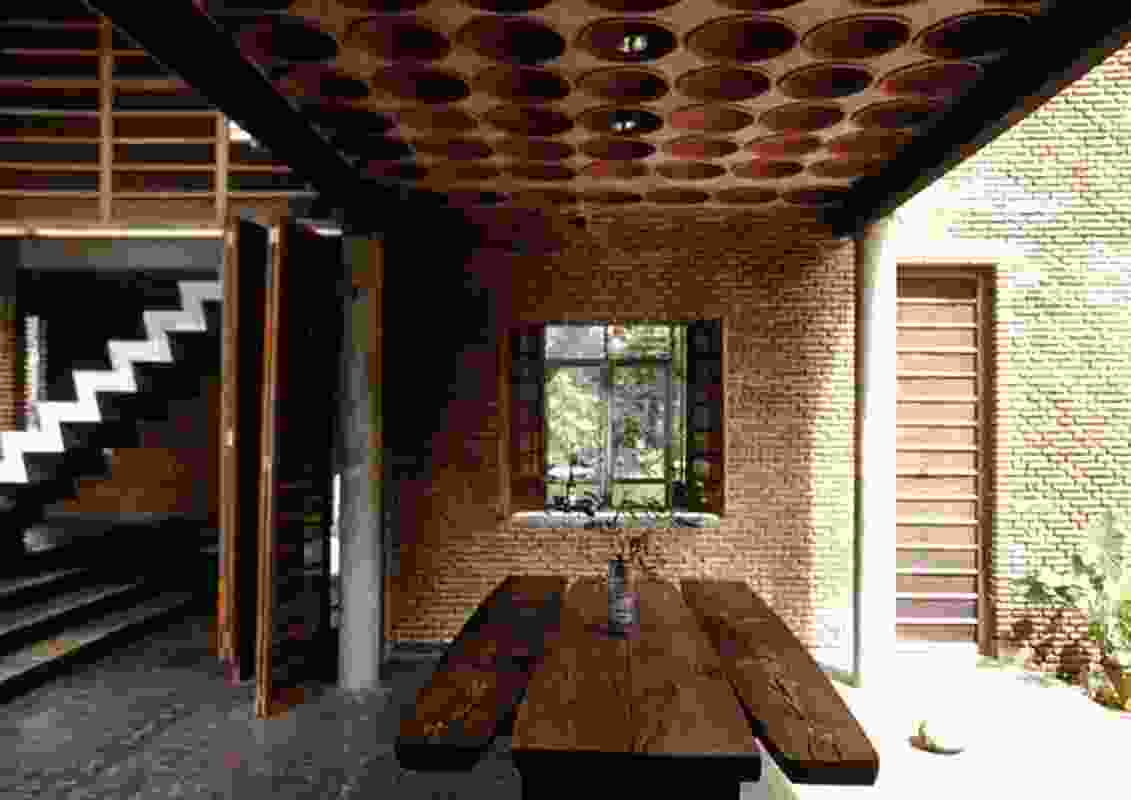 The original Wall House built in 2000 in Auroville, India.
