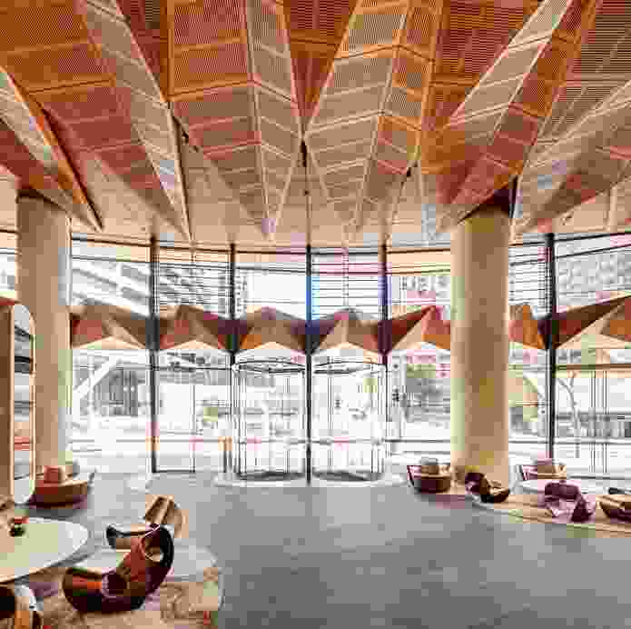 "The marine plywood canopy evokes a ""line of trees along the edge of the shore,"" undulating above the lobby."