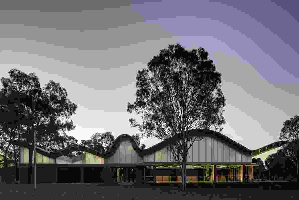 At night Woodcroft Neighbourhood Centre by Carter Williamson Architects glows through the opalescent polycarbonate cladding which enhances the roofline.