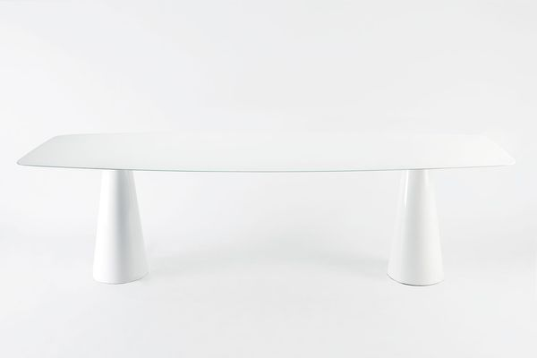 The Oui table for Kartell has elegant cone-shaped legs and is available in full colour or metallic versions.