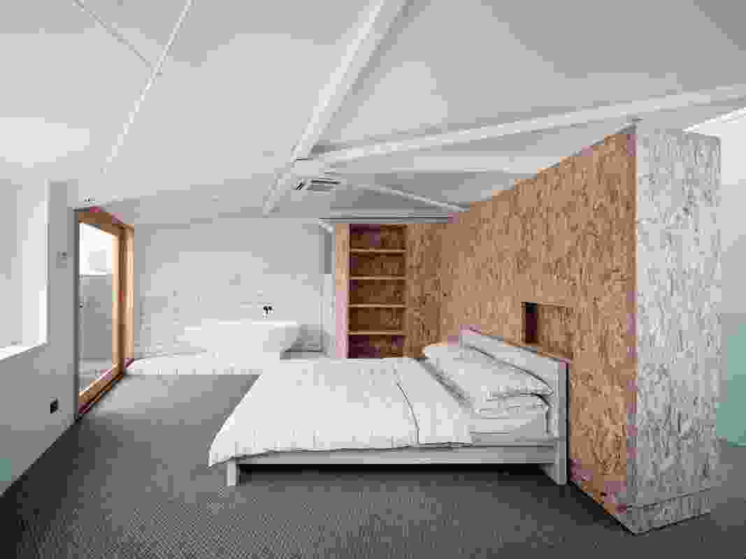 The upstairs bedroom features a wardrobe that can pivot around to make a second guest bedroom.