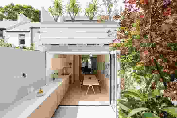 The original part of the house, comprising the ground floor, has been reimagined as a single long volume.
