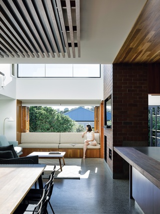 A series of atmospheric double-height volumes has been weaved through the long plan.
