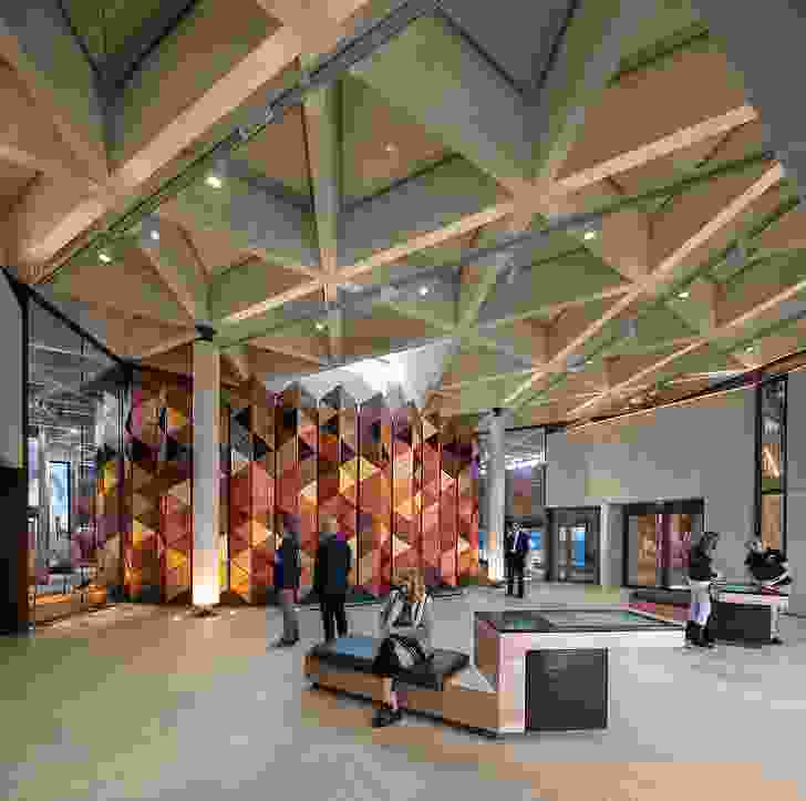 A large concertina screen of Australian timbers is the focal point of the lobby. Above it, a triangular skylight permits views of the lookout tower. Artwork (on left): Laurie Nilsen, Goolburris on Foreign Soil.