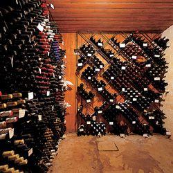 The wine cellar hidden beneath a closet.