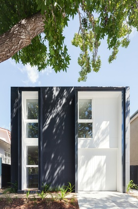 The black-and-white facade is a quiet and subdued addition to the streetscape.