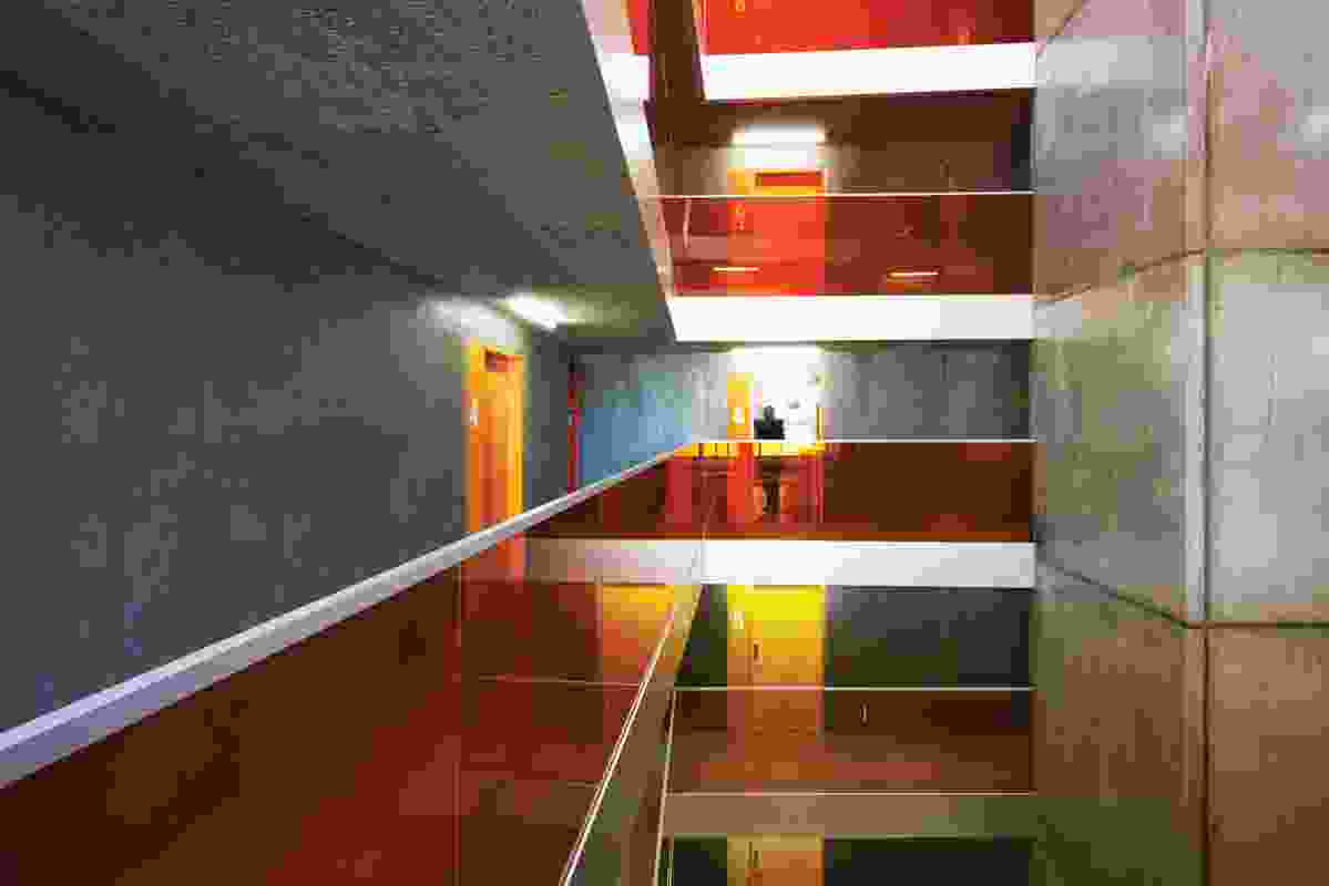 Internally, each floor reflects the gradation of colour from yellow at the entrance to red on the rooftop.