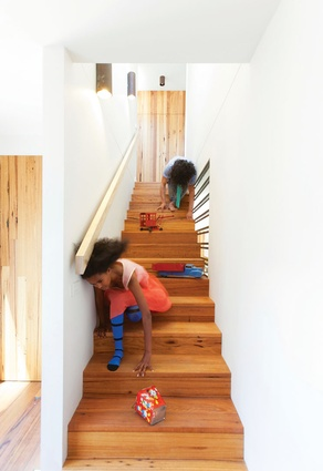 A timber stair leads to the new addition to the home.