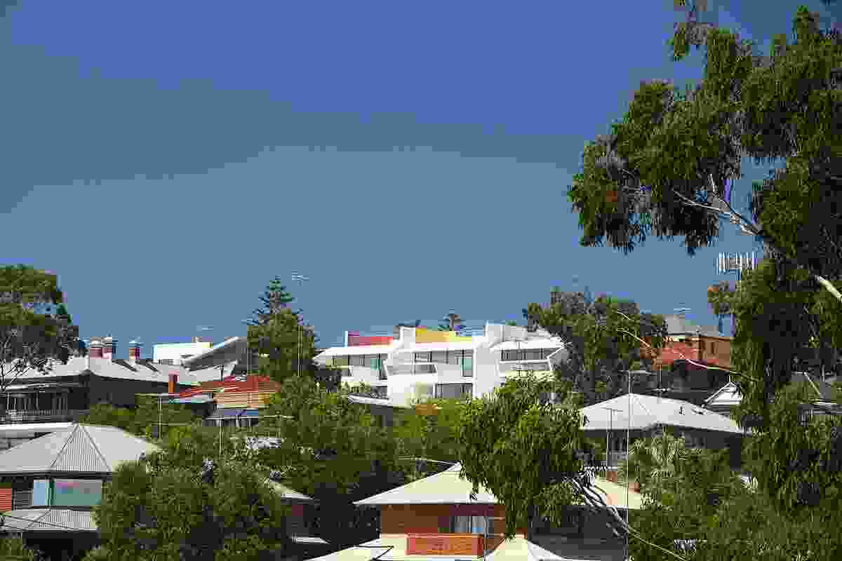 The Terrace Houses in Fremantle are embedded into the hillside, easily recognizable by their white forms and accents in primary colours.