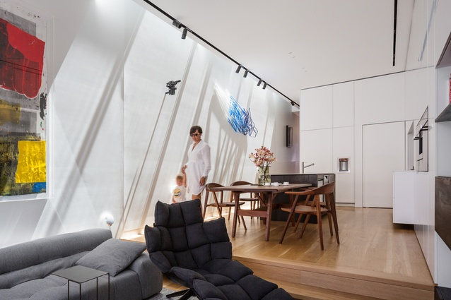 Two layers of skylights allow daylight to flood the wall of the living space. Artwork (L-R): Linus Bill and Adrien Horni; Anton Parsons; Dion Horstmans.