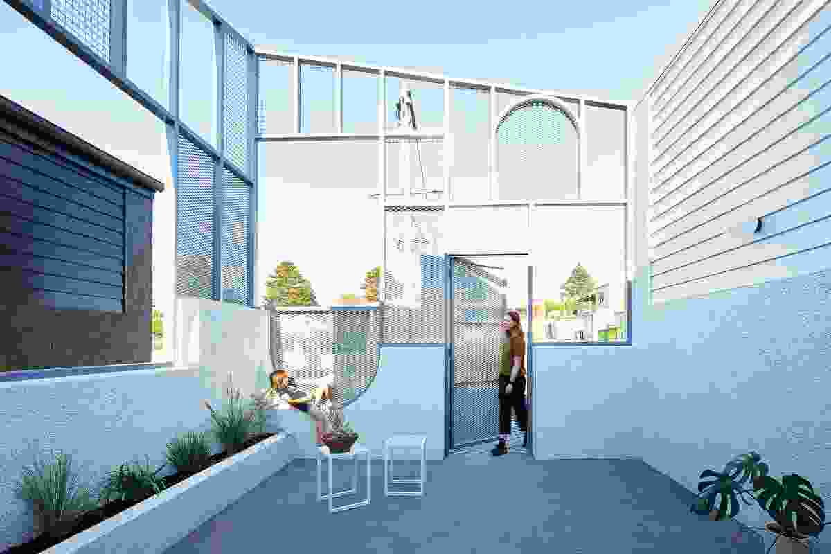 """Each house has a street-front courtyard, a space dedicated to """"hellos."""""""