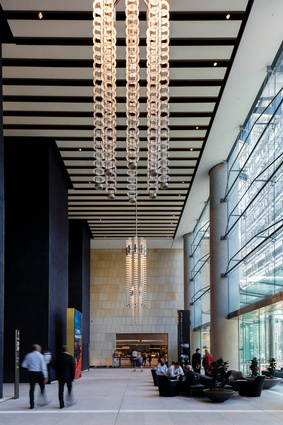 "The three-storey lobbies are ""heroically scaled"" spaces with subtle variations in mosaic colours and glazing tectonics."