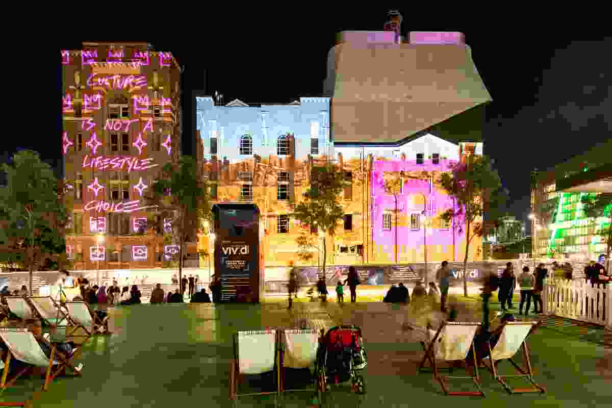 CULTURE IS NOT A LIFESTYLE CHOICE by Reko Rennie projected onto the Irving Street Brewery by Tzannes Architects.