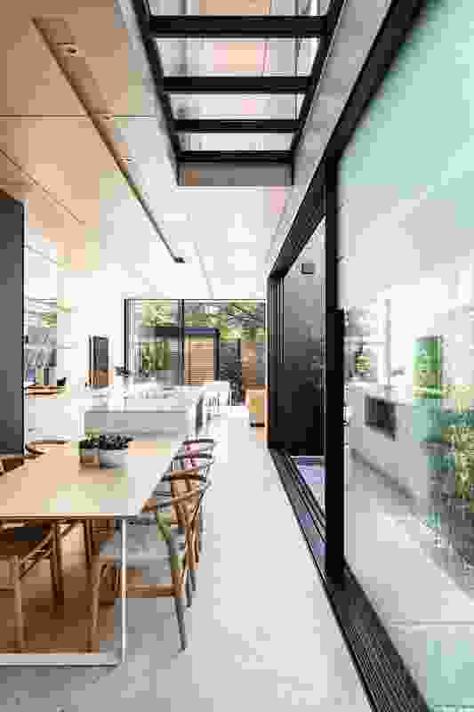 A glazed upper floor, large doors and a mirrored splashback make modest proportions appear expansive.