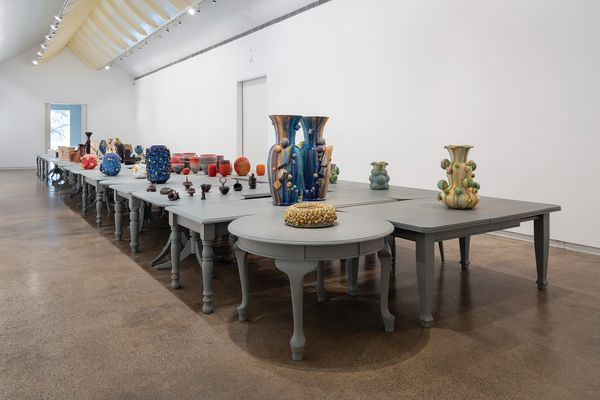 In the main gallery, the vessels are displayed on a surface composed of forty-five tables designed by John Wardle Architects.