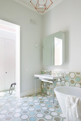 Hexagonal tiling in the bathroom is a nod to the Victorian era.