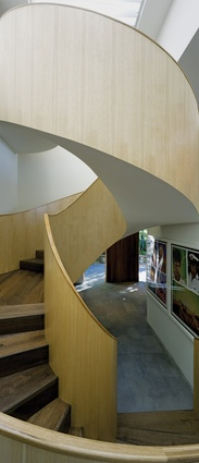 A stunning spiral staircase meanders vertically through the house.