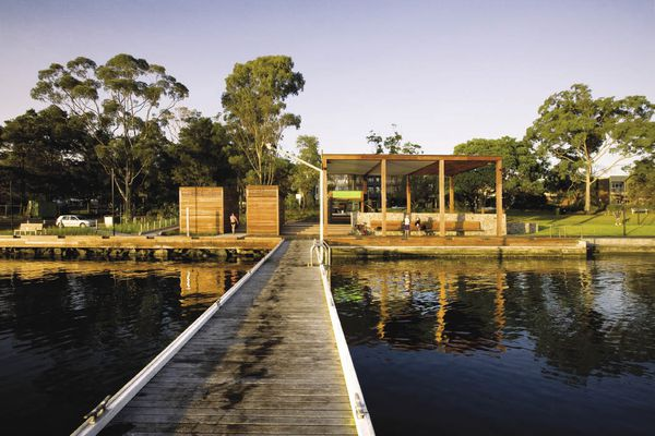 The generous shade structure opens out onto the lake swimming pool.