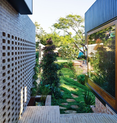 Bond brickwork frames and forms the house's surprisingly park-like rear garden.
