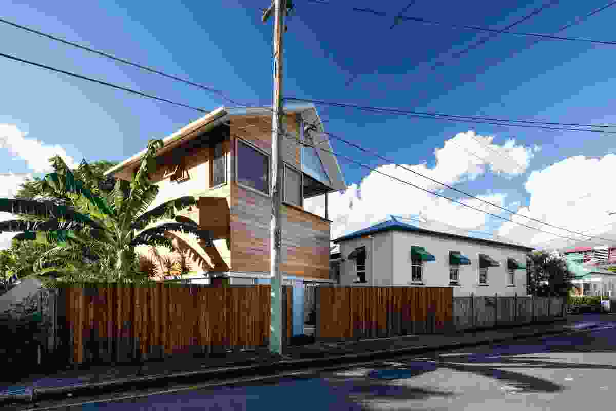 The detached addition to the rear of a Queensland cottage acknowledges the timber-and-tin character of the neighbourhood.