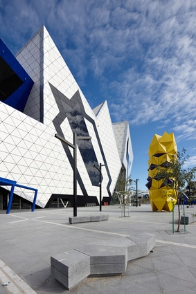On the eastern side stands the 10-metre yellow <em>Totem</em> sculpture by Perth artist Geoffrey Drake-Brockman.