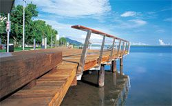 Wide, carefully detailed timber boardwalks move people through the esplanade in slices, swelling in places to provide places for rest and repose. Image: Stefan Jannides