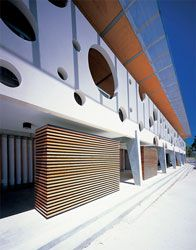 Tapered legs and timber screens underneath the