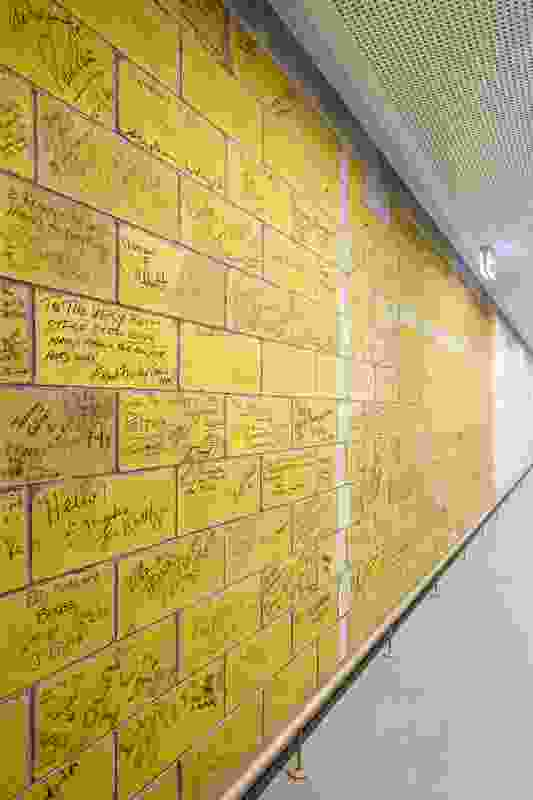 A famous wall of signatures has been deconstructed and reconstructed in the redevelopment of Her Majesty's Theatre by Cox Architecture.
