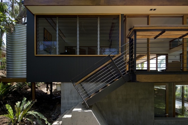 The main living area is lifted up to capture sweeping views over the surrounding suburbs.