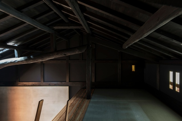 The loft sleeping space above the bathroom box in the Kyoto Terrace House by Atelier Luke.